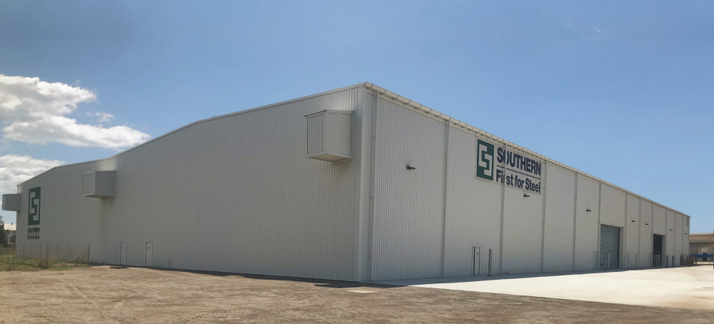 Exterior of a Big white warehouse