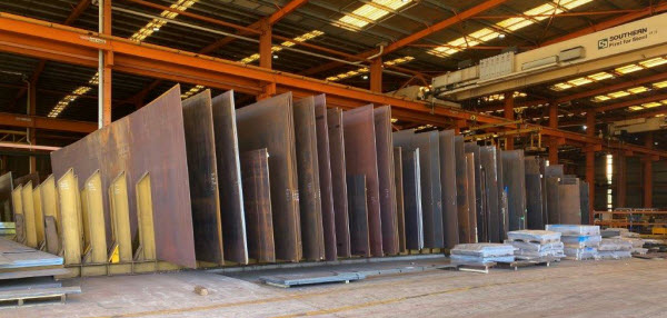 Stock of Steel plates inside a warehouse
